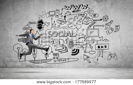 Running businessman on background of business plan sketches