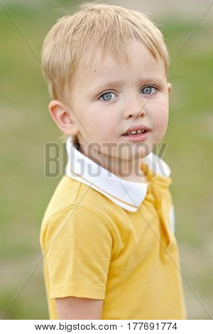 Portrait Of A Boy In The Summer Outdoors