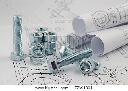Mechanical Engineering Technology. Nuts And Bolts On Paper Drawings