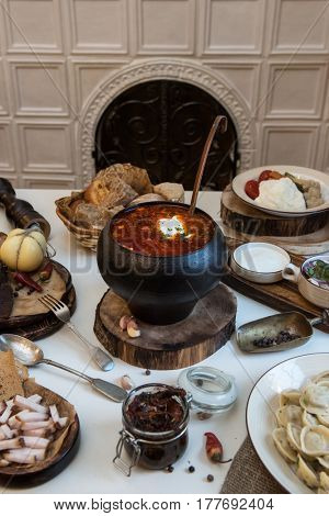 Russian food: borsch pickles cheese meat dumplings and fat