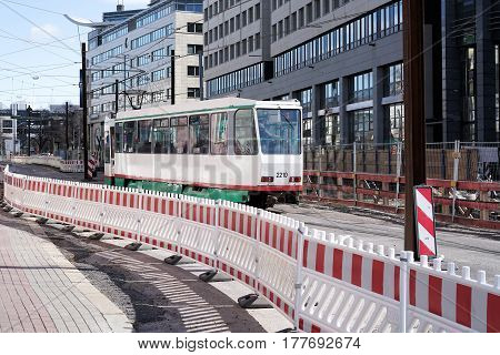 MAGDEBURG, GERMANY - MARCH 18, 2017: Tram at the construction site of the City Tunnel in Magdeburg. The city tunnel is the largest construction site in the city and is scheduled to be completed in 2019.