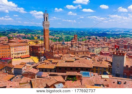 Aerial view over the historical medieval buildings including Piazza del Campo square in the old town of Siena Italy
