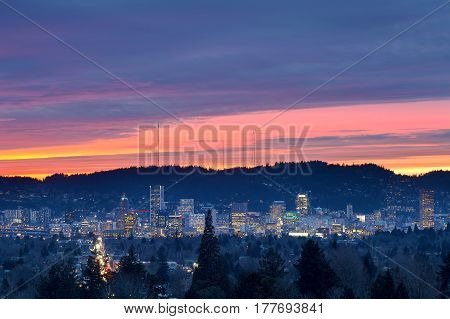 Dramatic colorful sunset sky over the city skyline of Portland Oregon