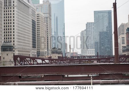 Clark Street Bridge connecting streets with tall buildings in great city