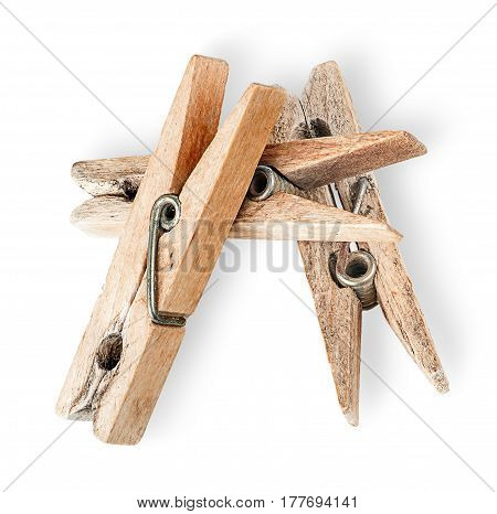 Heap of old wooden clothespins isolated on white background