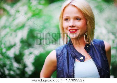 Magnificent portrait of a beautiful young blue-eyed blonde woman with perfect skin and bright lips, closeup.