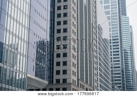 Close up modern high-rise blocks locating near each other in straight line in Chicago