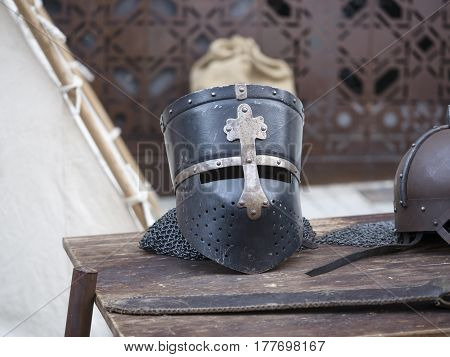 Helmets Medieval Of Knights On A Table