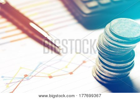 Summary Report And Financial Analyzing Concept, Pen And Calculator With Thailand Coin On Paperwork.