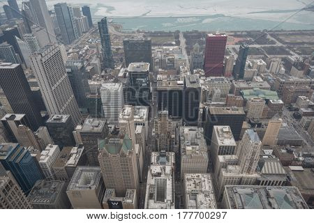 Top view of different majestic tall buildings situating near frozen river in United States