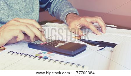 Young Woman Doing Finance At Home Office And Calculate About Cost On Desk.