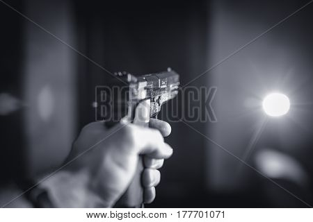 a loaded gun aimed to the side