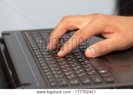 Work with your fingers on the keyboard on a laptop .