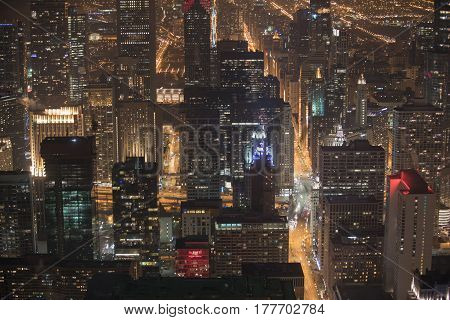 Top view of impressive endless multistory houses in Chicago at night