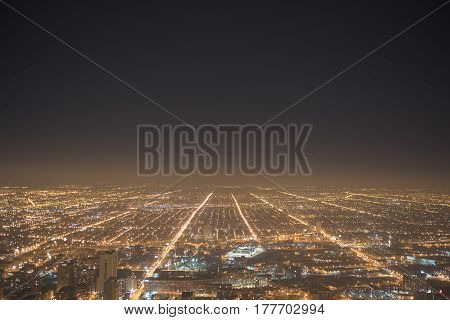 Top view of city night Illinois, United States. Endless high-rise buildings growing in distance