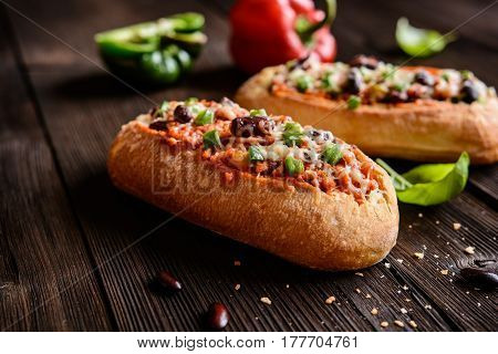 Baguette Stuffed With Minced Meat, Tomato Sauce, Bell Pepper, Beans, Onion, Garlic And Cheese