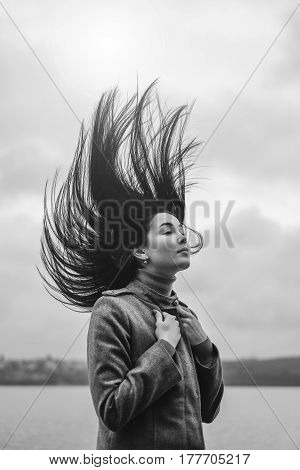 Brunette Woman Outdoor With Blowing Up Hair