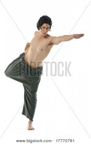 Young man performing Yoga exercises