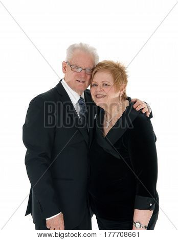 A beautiful senior citizen couple standing and embracing each other in suits isolated for white background.