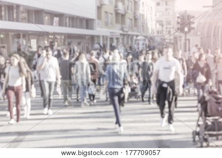 unrecognizable Pedestrians in modern city street blur abstract people background
