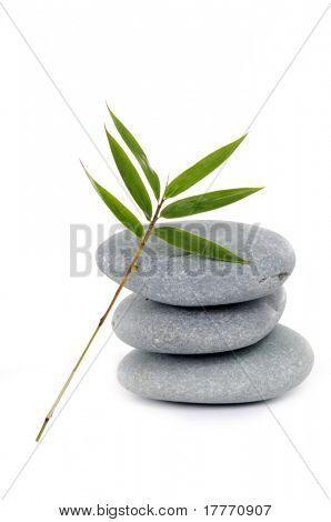 Three zen stones balanced with bamboo leaf poster