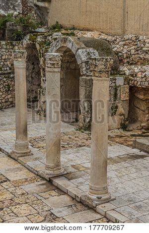 Cardo Maximus Roman Pillars. The Remains Of An Ancient Roman Pillars Located In Jewish Quarter In Je