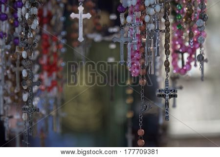 Christian cross and rosary at a street market in Jerusalem, Israel.