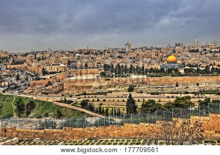 Panoramic view of Jerusalem Old city and the Temple Mount, Dome of the Rock and Al Aqsa Mosque from the Mount of Olives in Jerusalem, Israel.