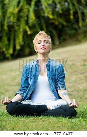 Closed Eyes Woman In Lotus Position