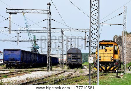 yellow motor locomotive on the railroad tracks