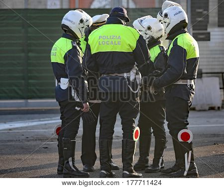 Italian Police And Some Riders With Helmet On His Head