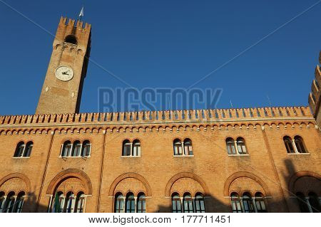 old building with red brick facade and tower called the Palace of the Three Hundred in Piazza dei Signori Treviso Italy