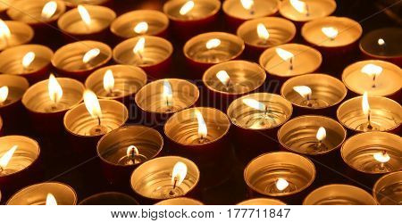 Candles Lit With The Warm Flame During The Religious Ceremony