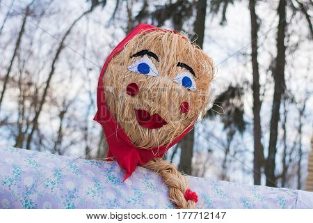 Photo of stuffed girl in Shovetide. An ancient Slavic festival of winter weddings, from which the custom of oven pancakes and entertainment was preserved.