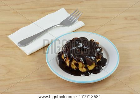 Decadent chocolate breakfast with chocolate frosting covered in chocolate syrup