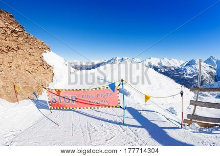 Closed ski piste banner high in the mountains