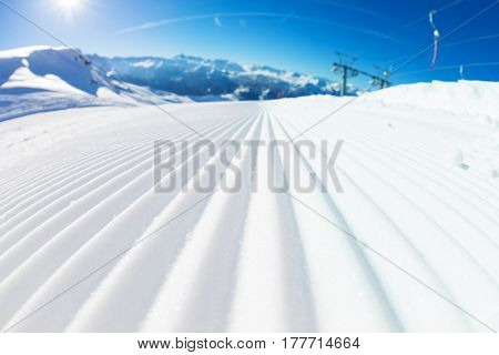 Close-up picture of fresh tracks of snowcat at the ski resort slopes