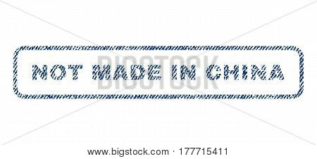 Not Made In China text textile seal stamp watermark. Blue jeans fabric vectorized texture. Vector caption inside rounded rectangular banner. Rubber sign with fiber textile structure.