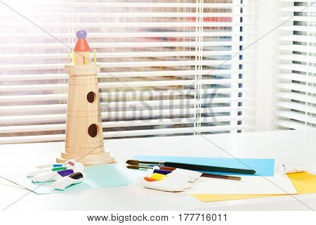 Stationery set and wooden model of tower for visual art lesson at the kindergarten or school