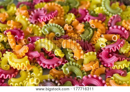 Colorful raw pasta. (Beet, carrot, paprika, spinach, grape seed).