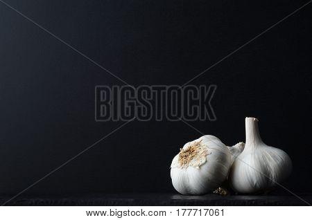 Garlic Bulbs Grouped On Black