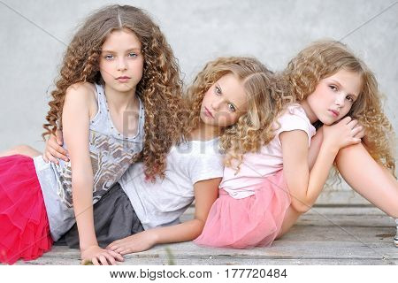 Portrait Of Three Girlfriends On The Nature