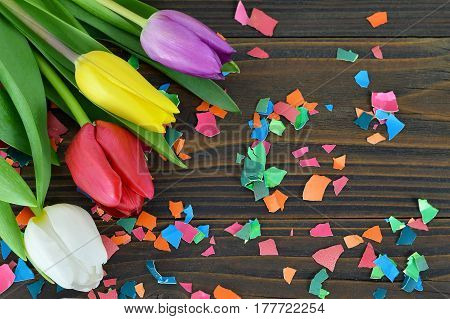 Easter card with Easter flowers and colored eggshell on wooden background