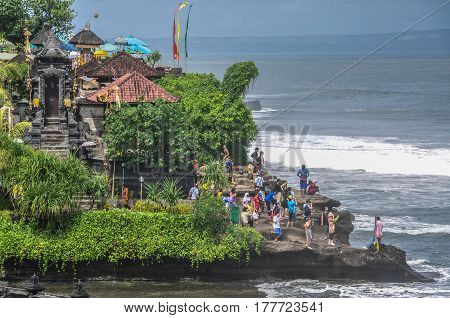 Bali,Indonesia-May 30,2010:View of tourists & devotees in the temple of the Tanah Lot Temple on Bali,Indonesia.Tanah Lot temple is a Hindu temple in Bali Indonesia that has a stunning natural beauty