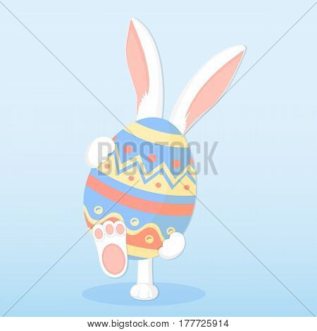 Easter bunny holding a big paschal egg.