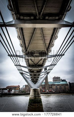 Perspective from the bottom of the Millennium Bridge in London with the background of the Museum of Modern Art Tate Modern
