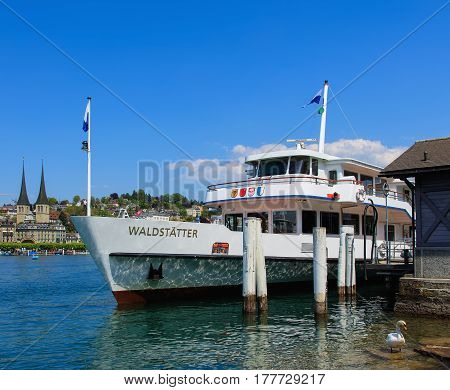 Lucerne, Switzerland - 7 May, 2016: MS Waldstatter at a pier on Lake Lucerne in the city of Lucerne. Lake Lucerne is a lake in central Switzerland, it is the fourth largest lake in the country.