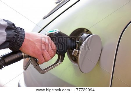 Man refueling car at a gas station