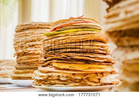 A stack of pancakes of different colors during the celebration Russian Shrovetide (pancake week)