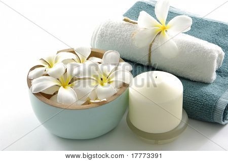 spa essentials and white frangipani